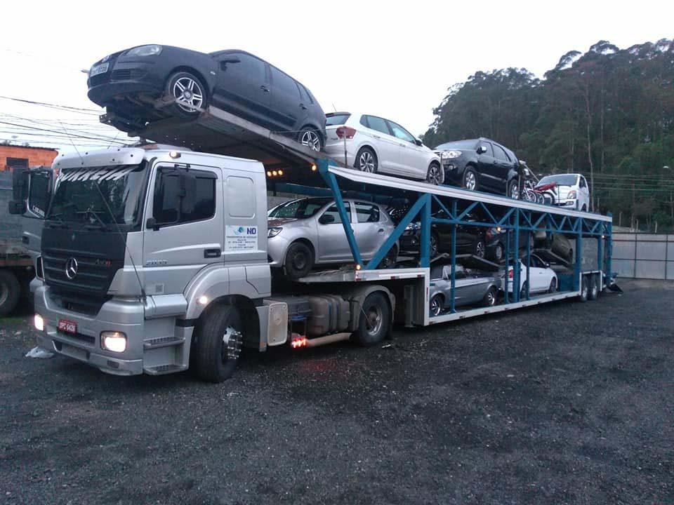Transporte de carros cegonha